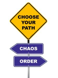 Road sign that says: Choose your path - chaos or order